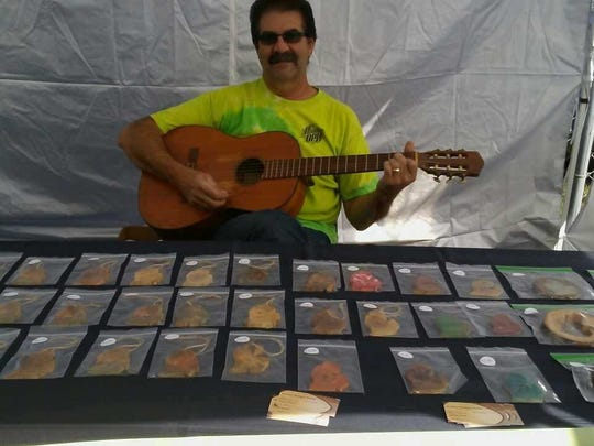 Joseph Roose of Highland Township enjoys playing guitar while selling his handcrafted wood art. He'll be on hand at the first Highland Fall Festival.