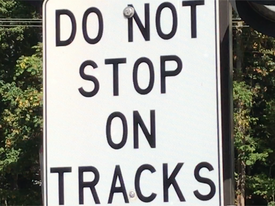Warning sign at Denville rail station.