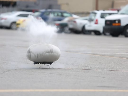 Instructors explode an airbag to give students an idea