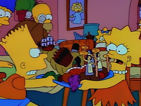 """Bart goes after Lisa's centerpiece on the """"Bart vs. Thanksgiving"""" episode of """"The Simpsons."""""""
