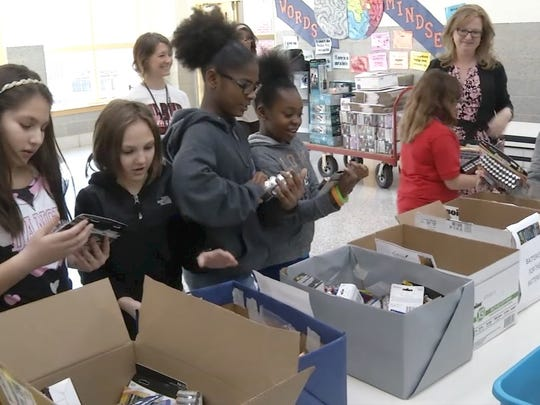 "Students at Kathleen H. Wilbur Elementary School counted 7,026 batteries at the culmination of a district-wide donation drive called ""Batteries for the Battered."" The batteries, donated by students, their families, and staff, will be sent to hurricane victims in Puerto Rico who are still without electrical power."
