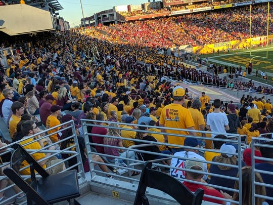 Fans watch the 2017 ASU-Arizona game at Sun Devil Stadium from the lower bowl on the north end.