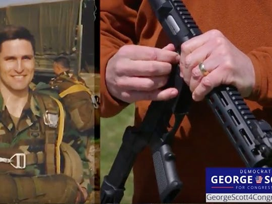 In a new TV ad, Democratic congressional candidate George Scott burns a semi-automatic rifle in a bonfire.
