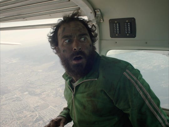 "Philip Burgers on a plane in a scene of ""The Passage"""