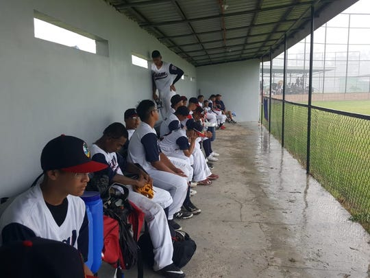 The Guam All-Stars wait out a rain delay in the middle of the third inning in their 23-win over India at Guam's Senior League Baseball All-Stars to a 23-0 victory over India at the Asia Pacific Regional Championships June 30 in the Philippines.