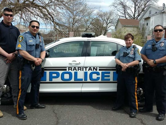 Raritan Borough police officers conducted a campaign last July to increase safety awareness among drivers and pedestrians on Somerset Street.  From left to right: Detective Christopher Wren, Sgt. James Raniere, Officer Kathleen Sausa, and Officer Joseph Nepomuceno.