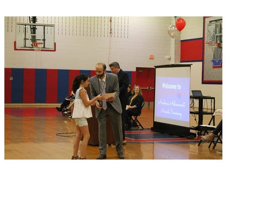 Alexa Canaan receiving her award from Gary Lubisco,