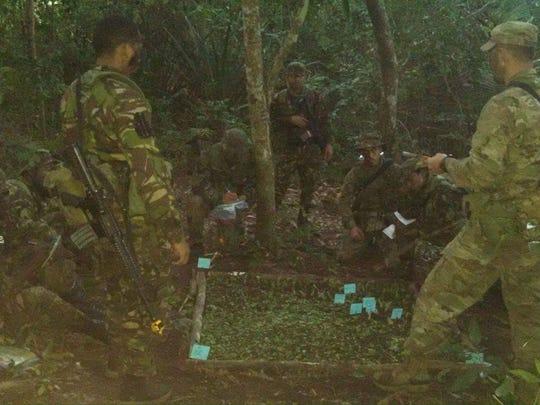 Louisiana National Guard 1st Lt. Kenrick Cormier (right)