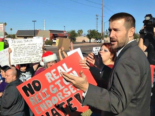 Pastor Steven Anderson addresses demonstrators protesting