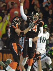 --Oregon State quarterback Derek Anderson, right, celebrates his first half touchdown with lineman Josh Linehan moments before halftime in their Civil War game against Oregon in Corvallis, Ore., Saturday, Nov. 20, 2004. (AP Photo/Don Ryan)
