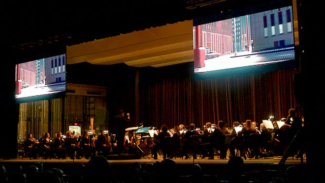 """Two 8-by-14 foot screens hung high about the Wichita Falls Symphony Orchestra for its sold-out multi-media pops concert """"Pixar in Concert"""" Saturday night at Memorial Auditorium. The program included visuals and live symphonic music from 14 Pixar films."""