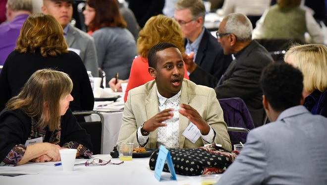 Farhan Abdi, St. Cloud Somali Youth Organization, joined the table talk discussion during the Greater St. Cloud Community Pillars in February 2016 at River's Edge Convention Center.