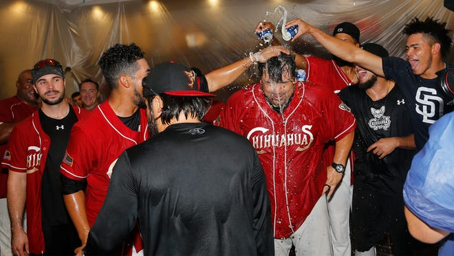 Chihuahuas Manager Rod Barajas is showered by his players after winning the PCL Pacific Southern Division by defeating Las Vegas 5-0 and the Albuquerque Isotopes' losing the second game of a double header to Salt Lake.