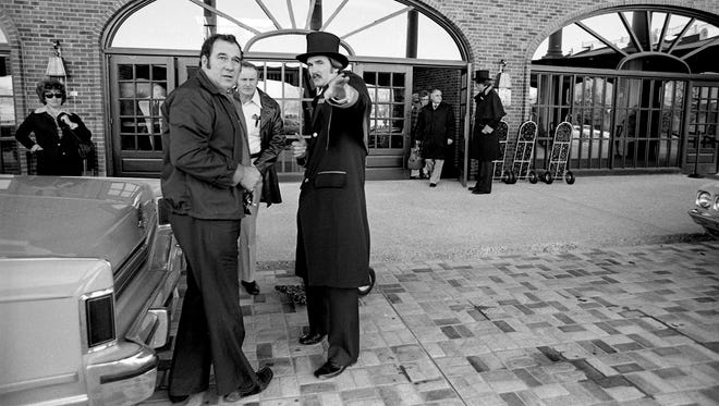 Top-hatted Rex Holmes, center right, helps out some of the very first guests to register at the new Opryland HotelÕs official opening of the $25 million facility Nov. 26, 1977.