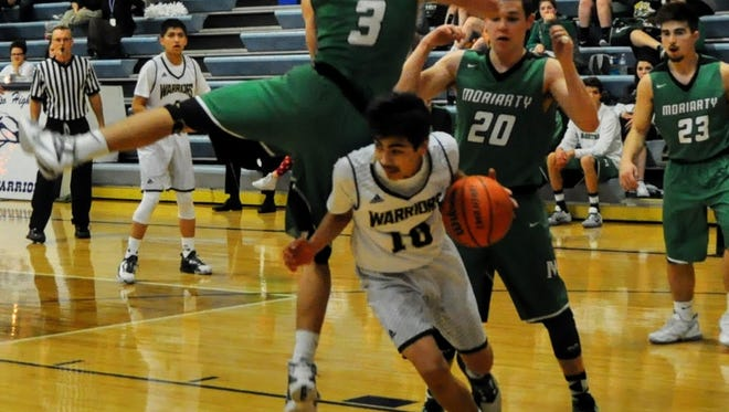 Ruidoso High's Josiah Polendo looks for the open spot as gravity takes hold of at Moriarty's Marvin Encinias.