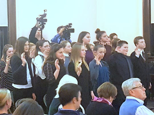 New members of Elmira Youth Court are sworn in during