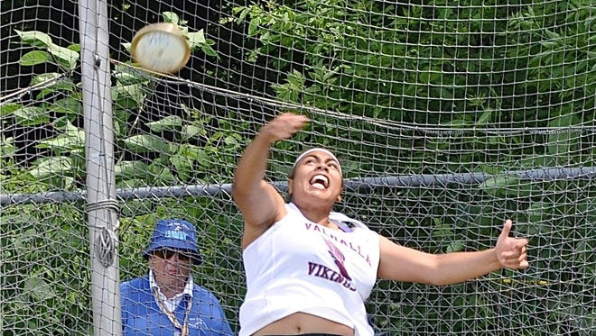 Valhalla's Sam Morillo throws the discus before winning the event, as well as the girls D2 shot put.
