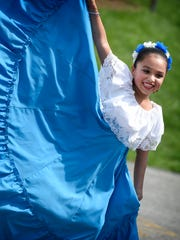 Nine-year-old Stephanie Barcenas performs with Malinalli during the fifth annual Fiesta Latina on Saturday, Aug. 27, 2016, at Beautex Playground in Lebanon.
