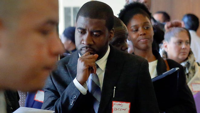 Job seekers attend a New York Department of Citywide Administrative Services job fair, in New York. It's been a tumultuous 2016, both financially and politically. The year may have left some people wondering, what's next?