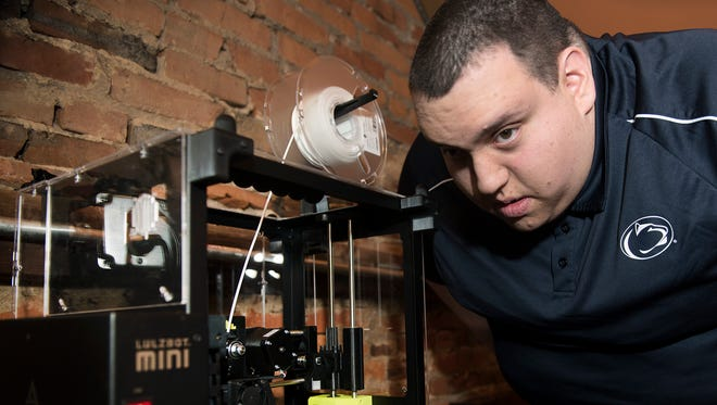 Student Brett Voce operates a 3-D printer on Monday, January 22, 2018. Penn State Mont Alto recently opened a Launch Box - an entrepreneurial hub - for folks who want to start their own business.