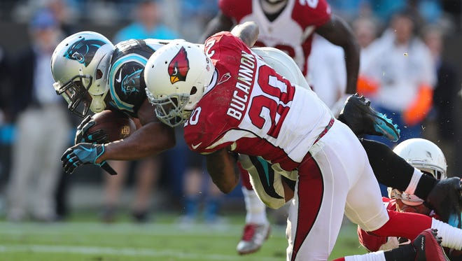 Oct 30, 2016: Arizona Cardinals outside linebacker Deone Bucannon (20) tackles Carolina Panthers running back Jonathan Stewart (28) during the second half at Bank of America Stadium. Carolina won 30-20.