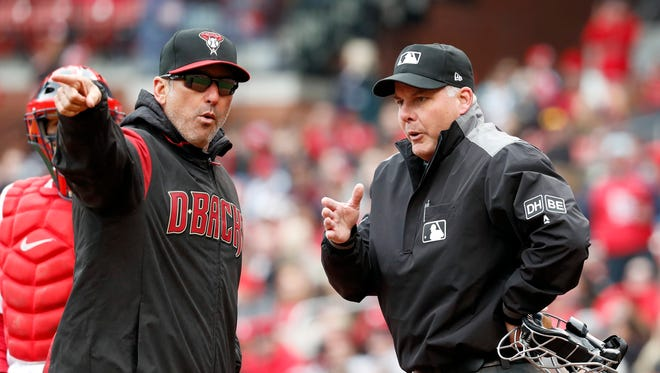 Arizona Diamondbacks manager Torey Lovullo, left, argues with home plate umpire Tim Timmons after being ejected by Timmons during the second inning of a baseball game against the St. Louis Cardinals Sunday, April 8, 2018, in St. Louis.