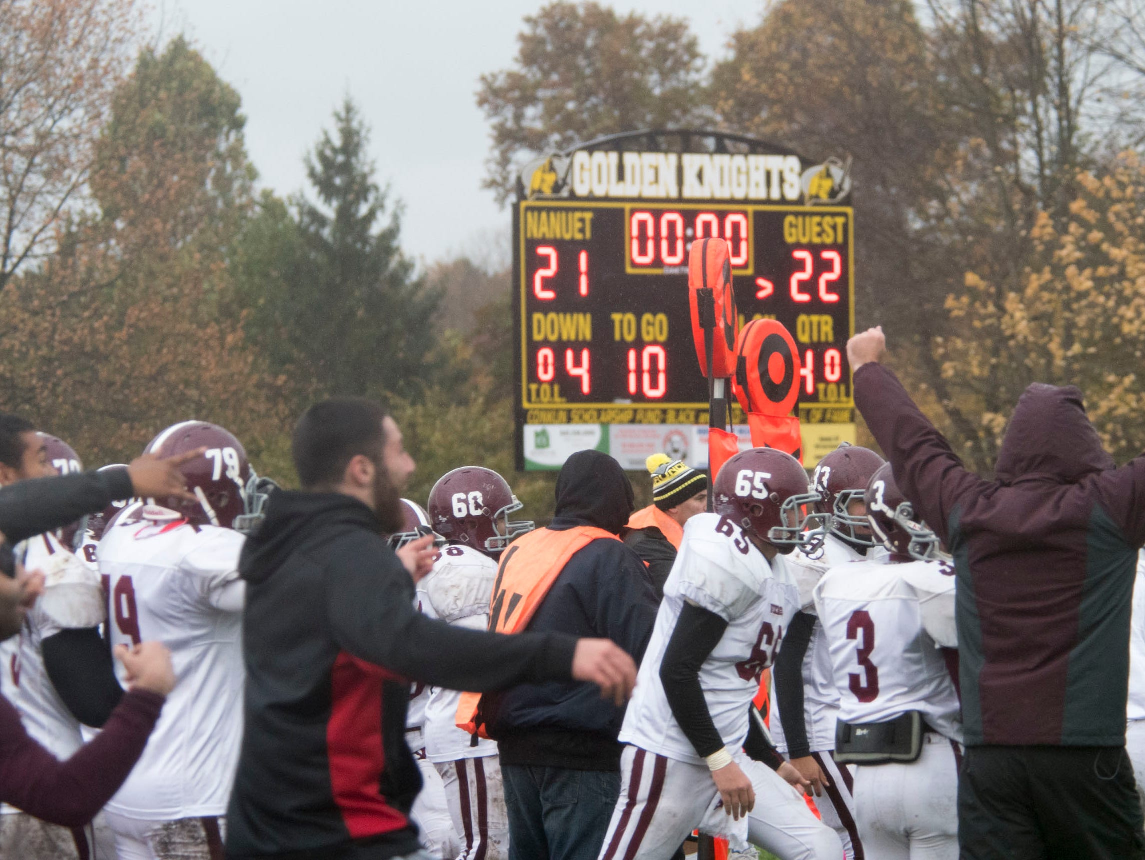 Valhalla coaches and players celebrate as the scoreboard tells the story of the Vikings' win over Nanuet on Saturday.