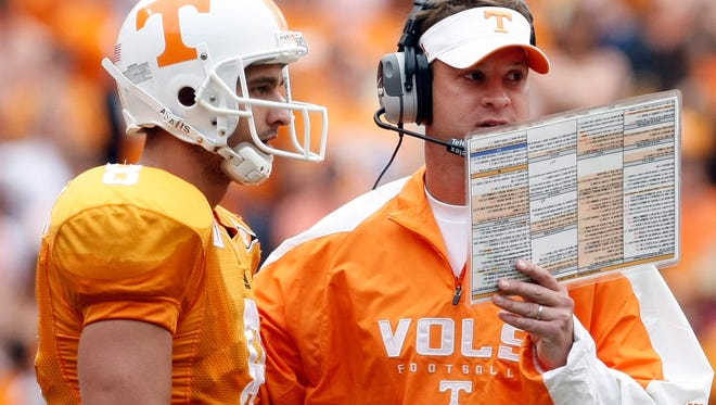 Tennessee coach Lane Kiffin (right) talks to quarterback Jonathan Crompton against Georgia on Oct. 10. Kiffin, now the Alabama offensive coordinator, makes his return to Knoxville on Saturday to face his old team.