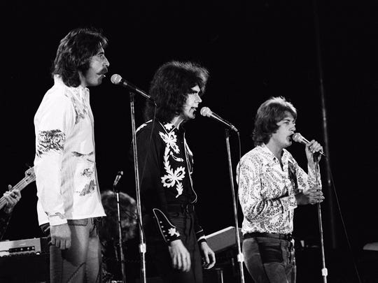 Three Dog Night members Chuck Negron, left, Danny Hutton,