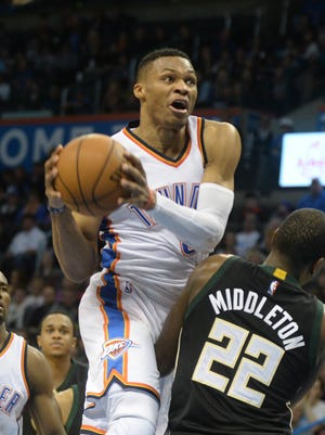 Thunder guard Russell Westbrook drives to the basket against Bucks guard Khris Middleton during the fourth quarter at Chesapeake Energy Arena.