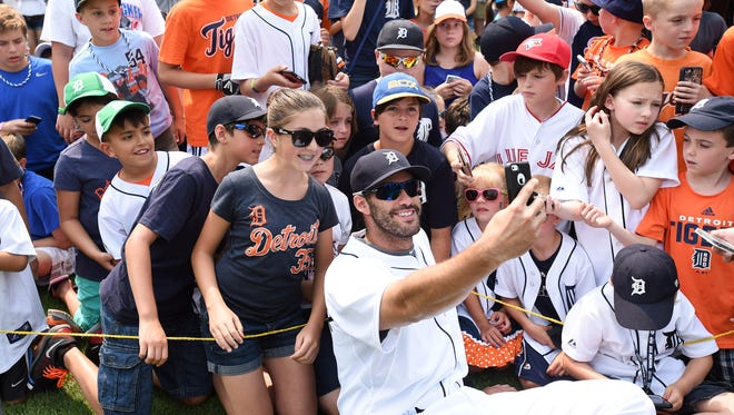 J.D. Martinez takes a selfie with fans during Tigers Photo Day on July 5.