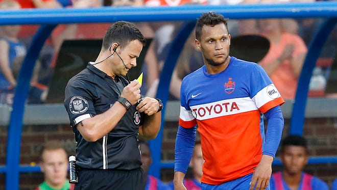 FC Cincinnati Kenney Walker (6) appeals a yellow card in the first half of the USL Soccer match between FC Cincinnati and Charlotte Independence at Nippert Stadium on June 10, 2017