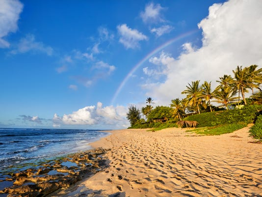 rainbow over the popular surfing place Sunset Beach, Oahu, Hawaii