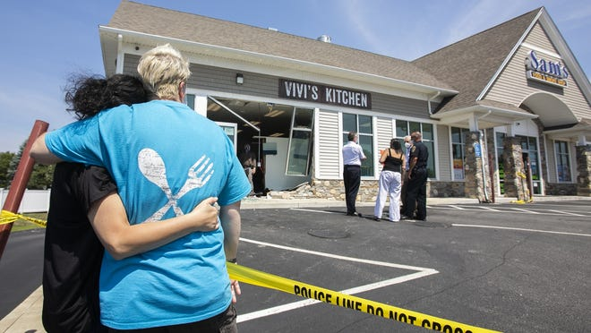 ViviþÄôs Kitchen owners Vivi Karastamatis and Christine Martino of Hanover hug one another as they watch Rockland first responders asses the scene of their restaurant after a woman accidentally drove her Toyota Camry into the building on Tuesday morning, July 7, 2020. No injuries were reported at the scene.