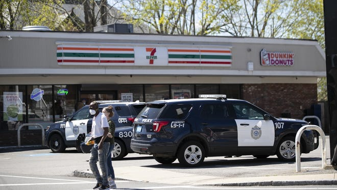 FILE - The 7-Eleven at 304 Belmont St. in Brockton was the scene of an armed robbery, Monday, Sept. 28, 2020. This May 2020 file photo shows police cruisers outside the store after it was struck by gunfire during a drive-by shooting on Manomet Street.