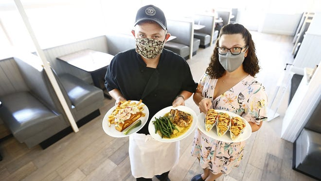 Sean Martin, left, is the chef at Stars on Hingham Harbor. At right is manager Amanda Albee.
