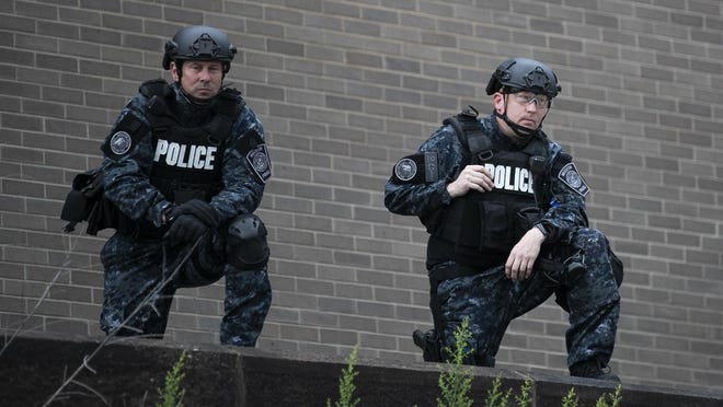 From above on the elevated police station ramp, officers observe hundreds of protesters gathered in front of the Brockton police station, Tuesday, June 2, 2020.