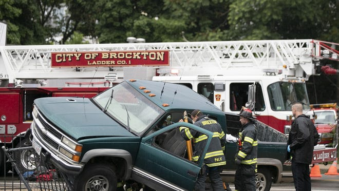 Brockton firefighters responded to an accident involving a green Chevy truck that crashed into the fence outside of St. Theresa Church on North Main Street in Brockton on Wednesday July 1, 2020. At least one person was transported by ambulance to an area hospital.
