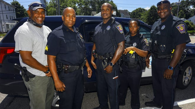The Brockton Police Department is one of the most diverse in the state of Massachusetts. Some of its members include, from left, Detective Ernie Bell, Sgt. Stan David, Officer Robert Greyson, Officer Jen Polynice and Officer Frank Coulanges, who posed for a photograph on Thursday, July 16, 2020, in Brockton.