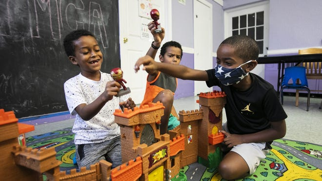 Ibrahim Veiga, 7, Jason Alves, 7, and Jonathan Soto, 7, play after lunch at the Old Colony YMCA youth branch summer program at 465 Main Street in Brockton on Wednesday, Aug. 19, 2020.