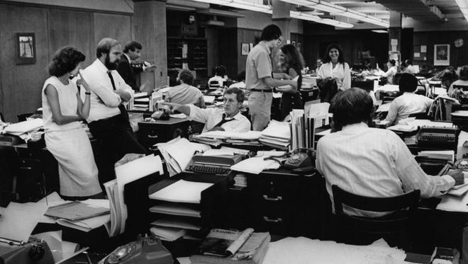 Tennessean newsroom, October 1979. John Seigenthaler seated in the center. Photo by Jimmy Ellis/Staff, October 25, 1979