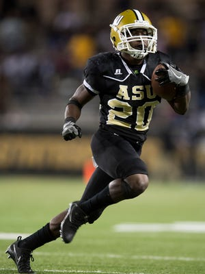 Alabama State's Ezra Gray carries against Alcorn at Hornet Stadium on the ASU campus in Montgomery, Ala. on Thursday October 5, 2017.