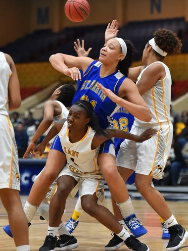 St. Martin's Daphane White (21) is fouled by a host