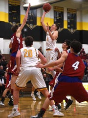 Galena's Moses Wood (11) shoots while taking on Reno