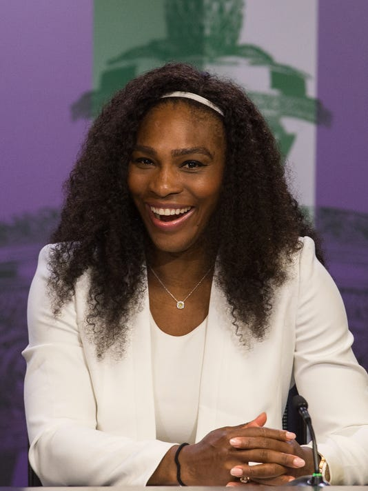 Serena Williams of the United States smiles during a press conference after defeating Garbine Muguruza of Spain in the final of the women's singles final at the All England Lawn Tennis Championships in Wimbledon, London, Saturday July 11, 2015. (Javier Garcia/Pool Photo via AP)