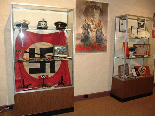 """The exhibit will be on display in the Montgomery Gallery of the Johnson Humrickhouse Museum through Sept. 9. Bill Given, who recently hosted a tour of the exhibit, said """"it's important to remember what all the men and women went through so we could have the freedoms we have here in America today."""""""