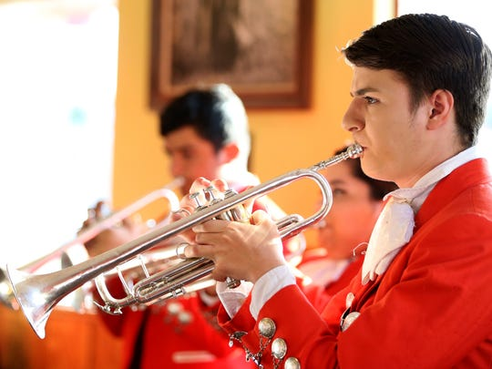 Jonathan Gomes, 17, a member of the Premont High School mariachi band, performs with band members during an April 2016 fundraiser at the Oasis Restaurant in Premont. The Premont Mighty Cowboy Band and Mariachi Estrella were selected as the 2017 Section 6 recipient of the National High School Heart of the Arts Award by the National Federation of State High School Associations.