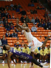 UTEP'S Lee Moore collides with Alcorn State's Devonte Hampton as Moore attempted to score Sunday. Moore was called for charging.