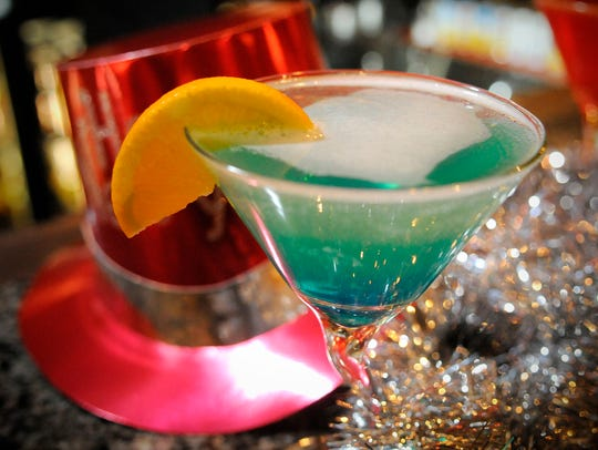 A martini called Inertia is ready to serve at the Red Carpet Martini Lounge in this Times photo.