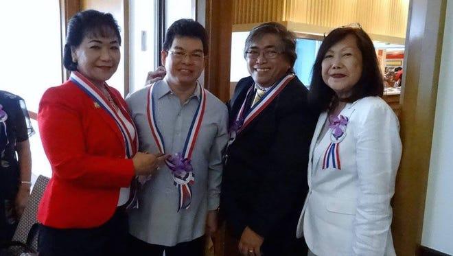 From left, Lynda Tolan, Philippine Consul General Marciano de Borja, Bill de la Pena, and Chet Brocka-Neri take a photo.
